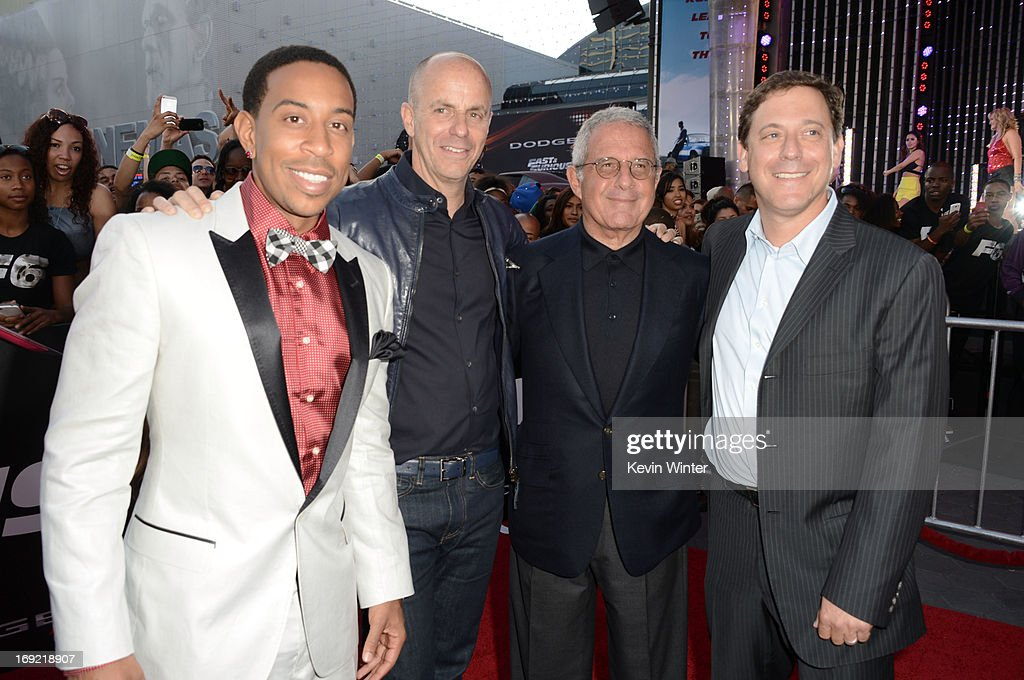 Actor Chris 'Ludacris' Bridges, producer Neal Moritz, President and Chief Operating Officer of Universal Studios Ron Meyer and Universal Pictures Chairman Adam Fogelson arrive at the premiere of Universal Pictures' 'Fast & Furious 6' at Gibson Amphitheatre on May 21, 2013 in Universal City, California.
