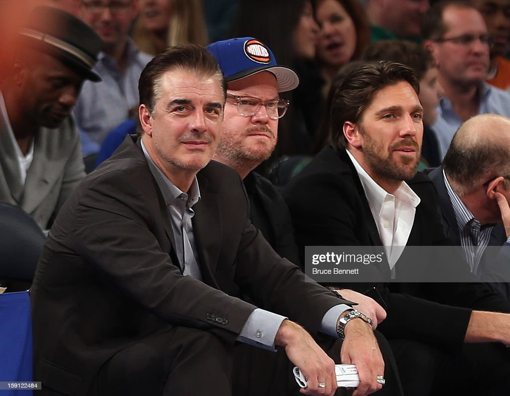 Actor Chris Noth, comedian Jim Gaffigan and New York Rangers goaltender Henrik Lundqvist take in the game between the New York Knicks and the Boston Celtics at Madison Square Garden on January 7, 2013 in New York City.