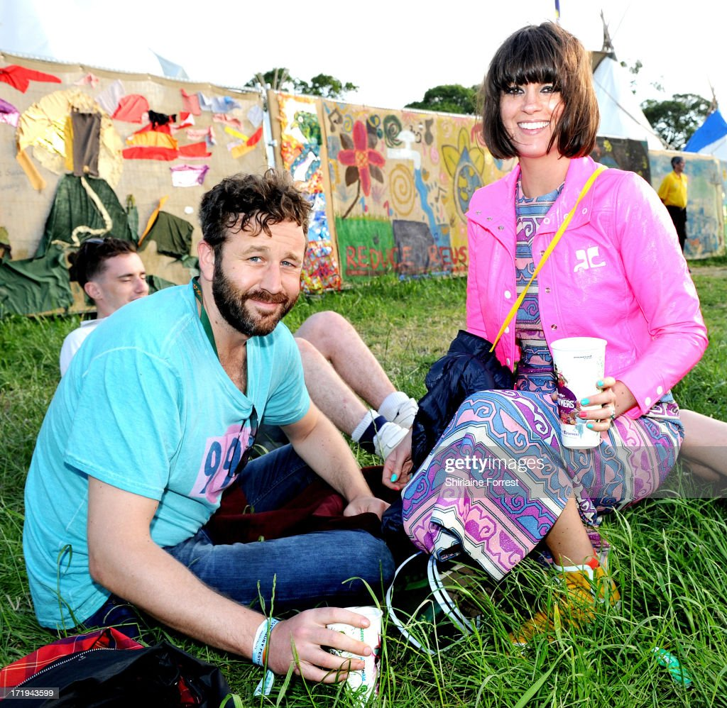 Actor Chris O'Dowd and wife television presenter Dawn Porter pose backstage during at day 3 of the 2013 Glastonbury Festival at Worthy Farm on June 29, 2013 in Glastonbury, England.