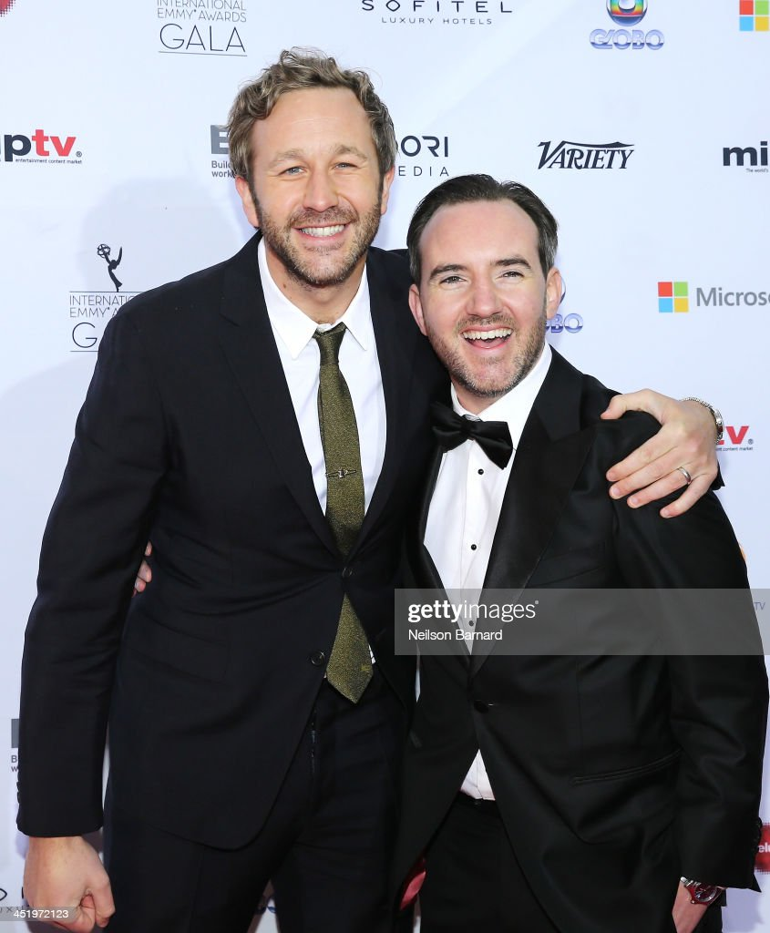 Actor <a gi-track='captionPersonalityLinkClicked' href=/galleries/search?phrase=Chris+O%27Dowd&family=editorial&specificpeople=814031 ng-click='$event.stopPropagation()'>Chris O'Dowd</a> (L) and writer Nick Vincent Murphy attend the 41st International Emmy Awards at the Hilton New York on November 25, 2013 in New York City.