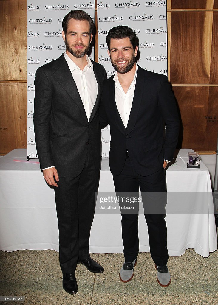 Actor Chris Pine (L) and Host Max Greenfield attend the 12th Annual Chrysalis Butterfly Ball on June 8, 2013 in Los Angeles, California.