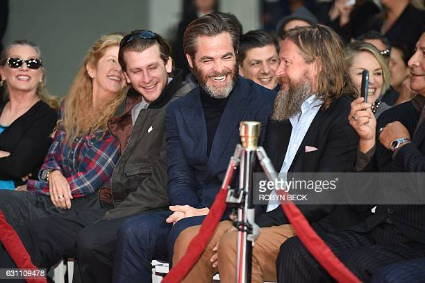 Actor Chris Pine Director David Mackenzie and Ben Foster talk at Jeff Bridges Hand and Footprint Ceremony at the TCL Chinese Theater in Hollywood...