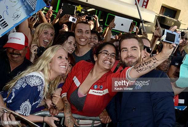 Actor Chris Pine poses with fans as he arrives at the Premiere of Paramount Pictures' 'Star Trek Into Darkness' at Dolby Theatre on May 14 2013 in...