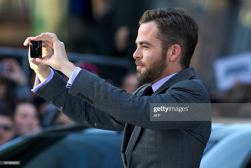 US actor Chris Pine takes a picture with a mobile phone as he arrives for the international premier of his latest film 'Star Trek Into Darkness' in London's Leicester Square on May 2, 2013.