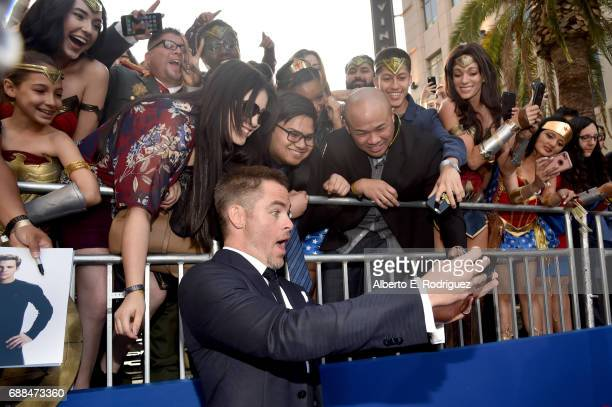 Actor Chris Pine takes a selfie with fans at the premiere of Warner Bros Pictures' 'Wonder Woman' at the Pantages Theatre on May 25 2017 in Hollywood...