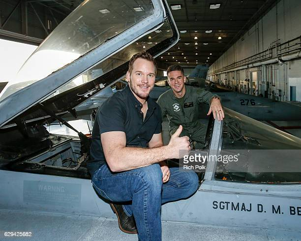 Actor Chris Pratt poses with a US Marine at Marine Corps Air Station Miramar on December 12 2016 in San Diego California