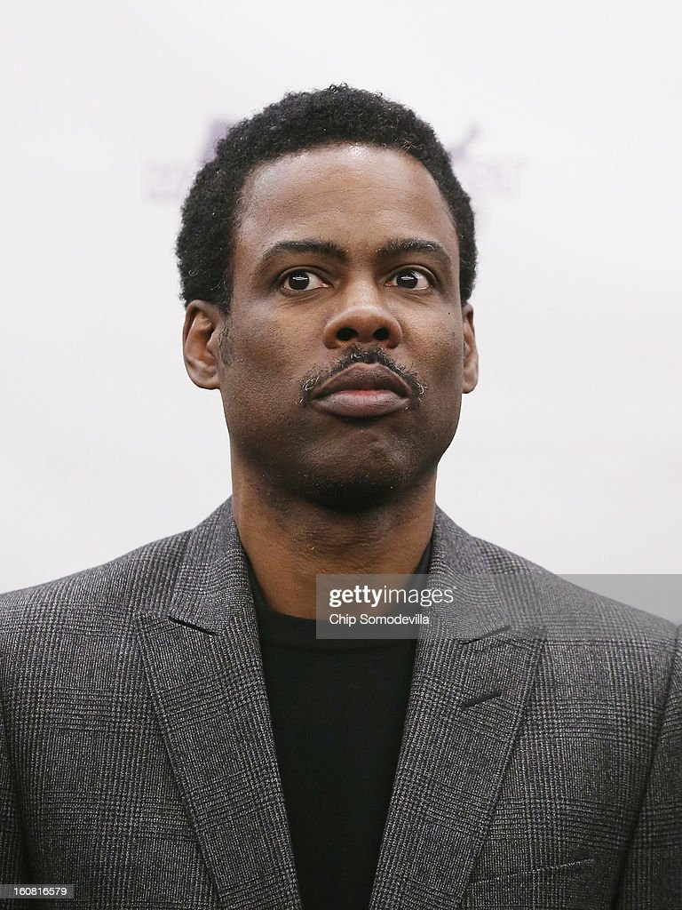 Actor Chris Rock participates in a press conference hosted by the Mayors Against Illegal Guns and the Law Center to Prevent Gun Violence at the U.S. Capitol February 6, 2013 in Washington, DC. The artists, activists and politicians called for manditory background check on all gun purchases among other restrictions.