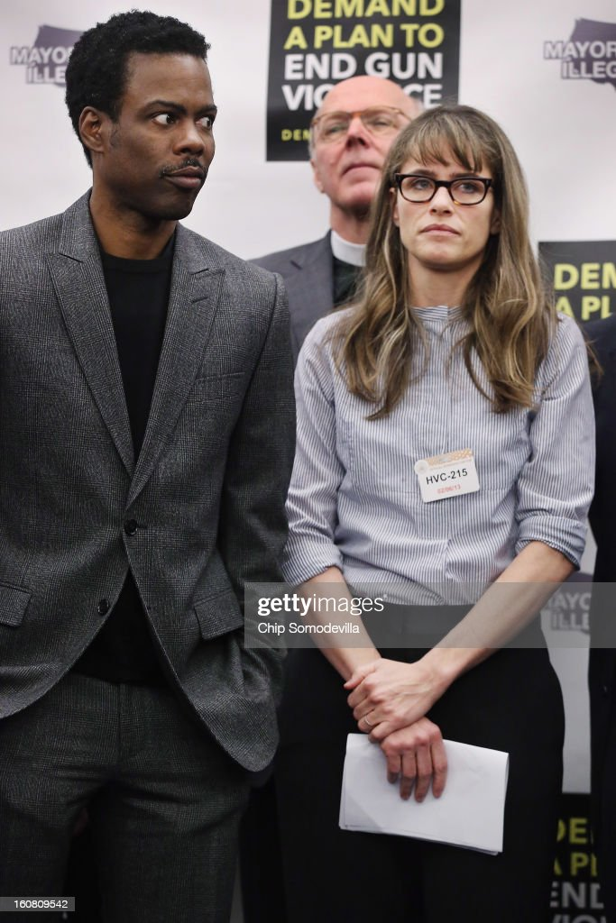 Actor Chris Rock, Rev. Thomthy Boggs and actor Amanda Peet participate a press conference hosted by the Mayors Against Illegal Guns and the Law Center to Prevent Gun Violence at the U.S. Capitol February 6, 2013 in Washington, DC. The artists, activists and politicians called for manditory background check on all gun purchases among other restrictions.