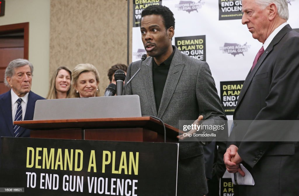 Actor Chris Rock (2nd R) speaks during a press conference hosted by the Mayors Against Illegal Guns and the Law Center to Prevent Gun Violence with (L-R) singer Tony Bennett, LCPGV Executive Director Robyn Thomas, Rep. Carolyn Maloney (D-NY) and Rep. Mike Thompson (D-CA) at the U.S. Capitol February 6, 2013 in Washington, DC. The artists, activists and politicians called for manditory background check on all gun purchases among other restrictions.
