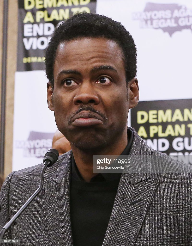 Actor Chris Rock speaks during in a press conference hosted by the Mayors Against Illegal Guns and the Law Center to Prevent Gun Violence at the U.S. Capitol February 6, 2013 in Washington, DC. The artists, activists and politicians called for manditory background check on all gun purchases among other restrictions.