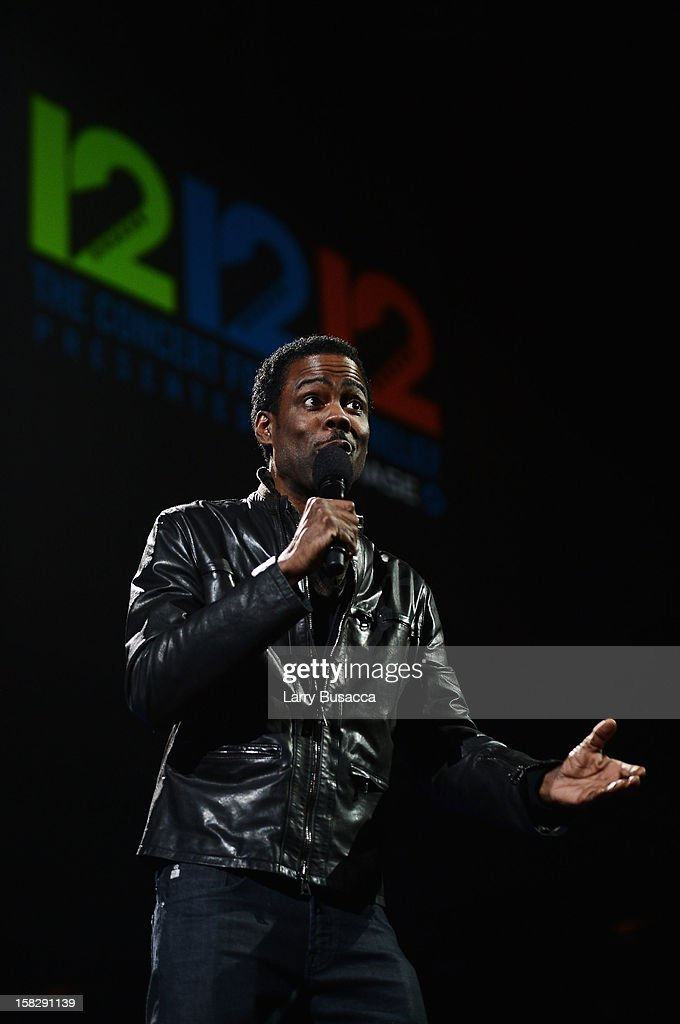 Actor Chris Rock speaks onstage at '12-12-12' a concert benefiting The Robin Hood Relief Fund to aid the victims of Hurricane Sandy presented by Clear Channel Media & Entertainment, The Madison Square Garden Company and The Weinstein Company at Madison Square Garden on December 12, 2012 in New York City.