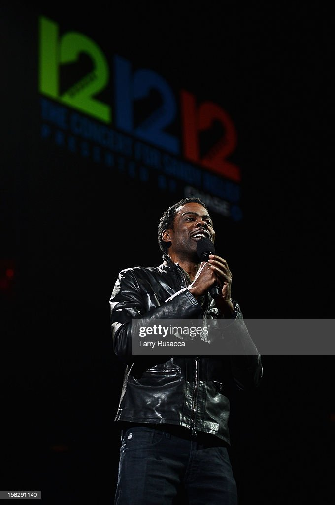 Actor <a gi-track='captionPersonalityLinkClicked' href=/galleries/search?phrase=Chris+Rock&family=editorial&specificpeople=202982 ng-click='$event.stopPropagation()'>Chris Rock</a> speaks onstage at '12-12-12' a concert benefiting The Robin Hood Relief Fund to aid the victims of Hurricane Sandy presented by Clear Channel Media & Entertainment, The Madison Square Garden Company and The Weinstein Company at Madison Square Garden on December 12, 2012 in New York City.
