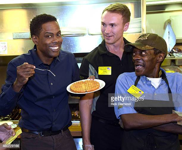 Actor Chris Rock stops by the Waffle House after the VIP screening of Paramount Pictures' 'Top Five' and meets employees Blake Parker Manager and Joe...