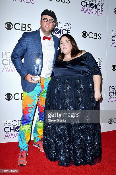 Actor Chris Sullivan and actress Chrissy Metz pose with an award in the press room during the People's Choice Awards 2017 at Microsoft Theater on...