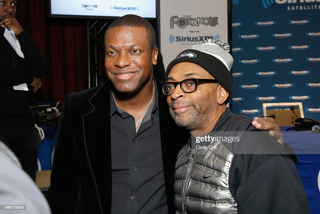 Actor Chris Tucker (L) and director Spike Lee attend SiriusXM's The Foxxhole at Super Bowl XLVIII Radio Row on January 31, 2014 in New York City.