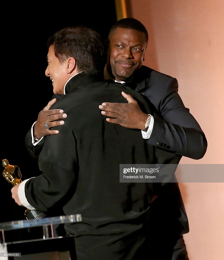 Actor Chris Tucker (R) presents an award onstage to honoree Jackie Chan during the Academy of Motion Picture Arts and Sciences' 8th annual Governors Awards at The Ray Dolby Ballroom at Hollywood & Highland Center on November 12, 2016 in Hollywood, California.