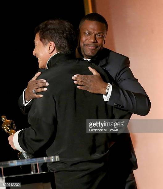 Actor Chris Tucker presents an award onstage to honoree Jackie Chan during the Academy of Motion Picture Arts and Sciences' 8th annual Governors...