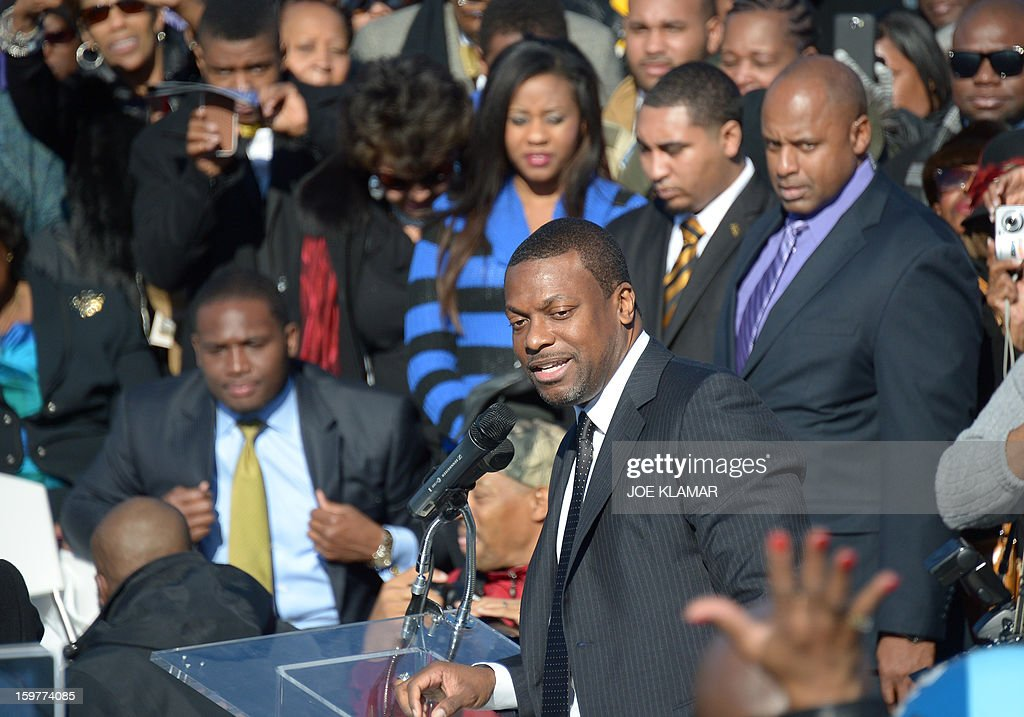 Actor Chris Tucker speaks under the statue of civil rights leader Martin Luther King, Jr. on the occasion of Martin Luther King Day at the MLK Memorial on January 20, 2013 in Washington. King is best known for his role in the advancement of civil rights using nonviolent civil disobedience.