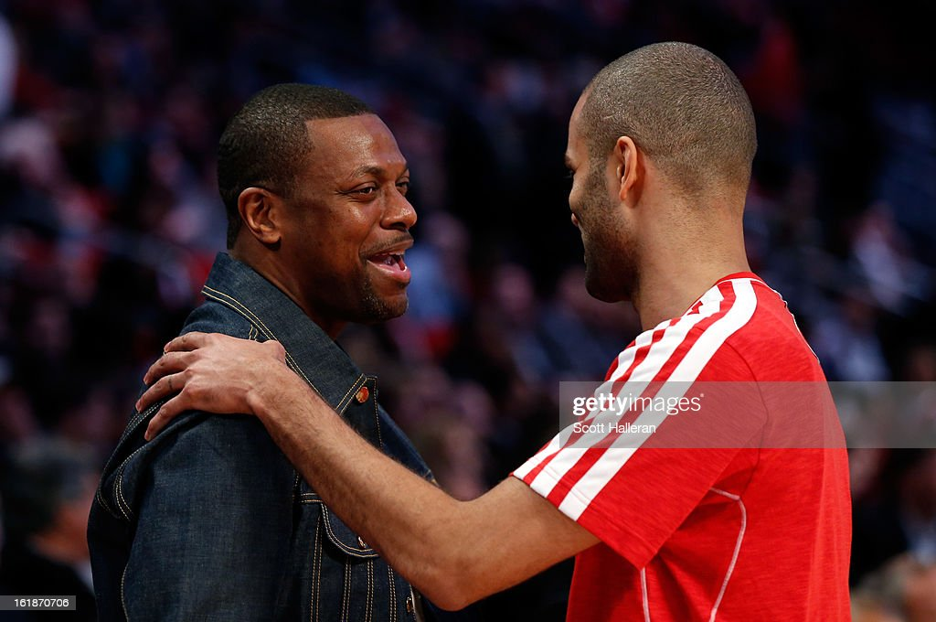 Actor Chris Tucker talks with Tony Parker #9 of the San Antonio Spurs and the Western Conference during the Taco Bell Skills Challenge part of 2013 NBA All-Star Weekend at the Toyota Center on February 16, 2013 in Houston, Texas.