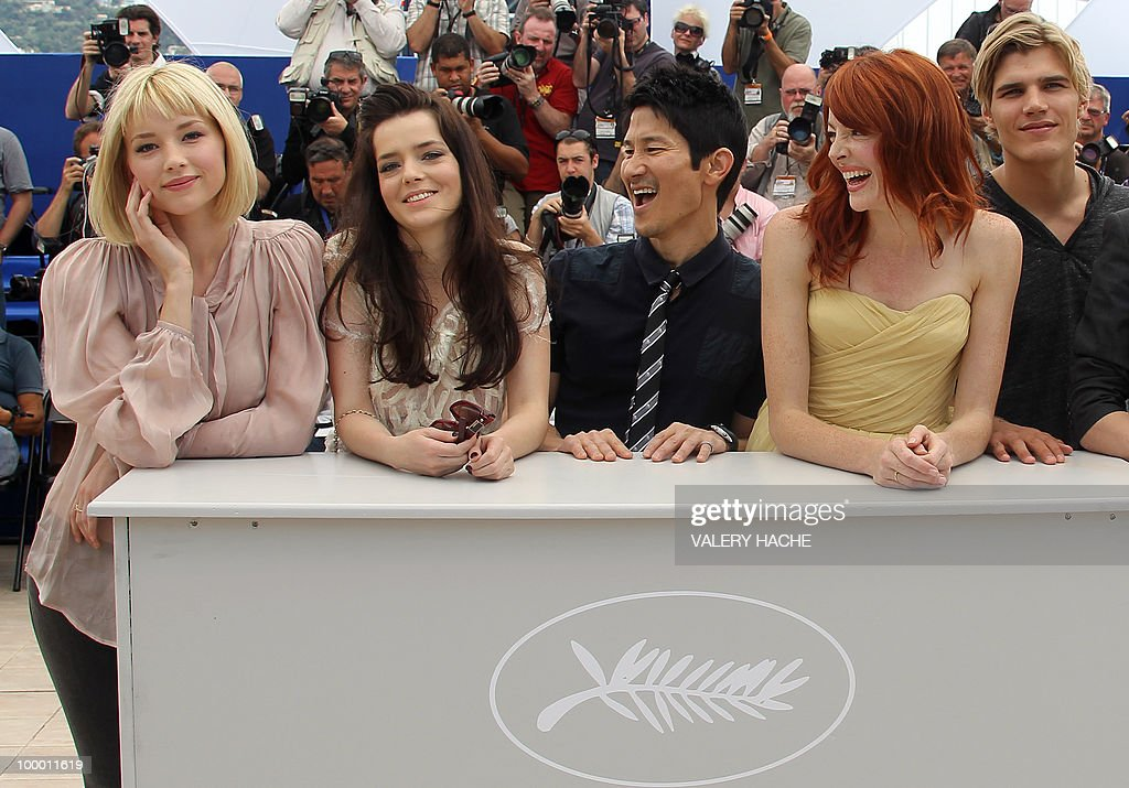 Actor Chris Zylka, actress Nicole LaLiberte, US director Gregg Araki, French actress Roxane Mesquida and US actor Haley Bennett pose during the photocall of 'Kaboom' presented out of competition at the 63rd Cannes Film Festival on May 15, 2010 in Cannes.