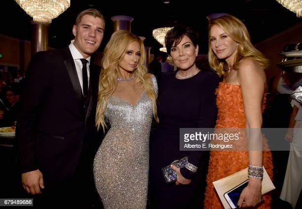 Actor Chris Zylka Paris Hilton TV personality Kris Jenner and fashion designer Dee Ocleppo attend the 24th Annual Race To Erase MS Gala at The...