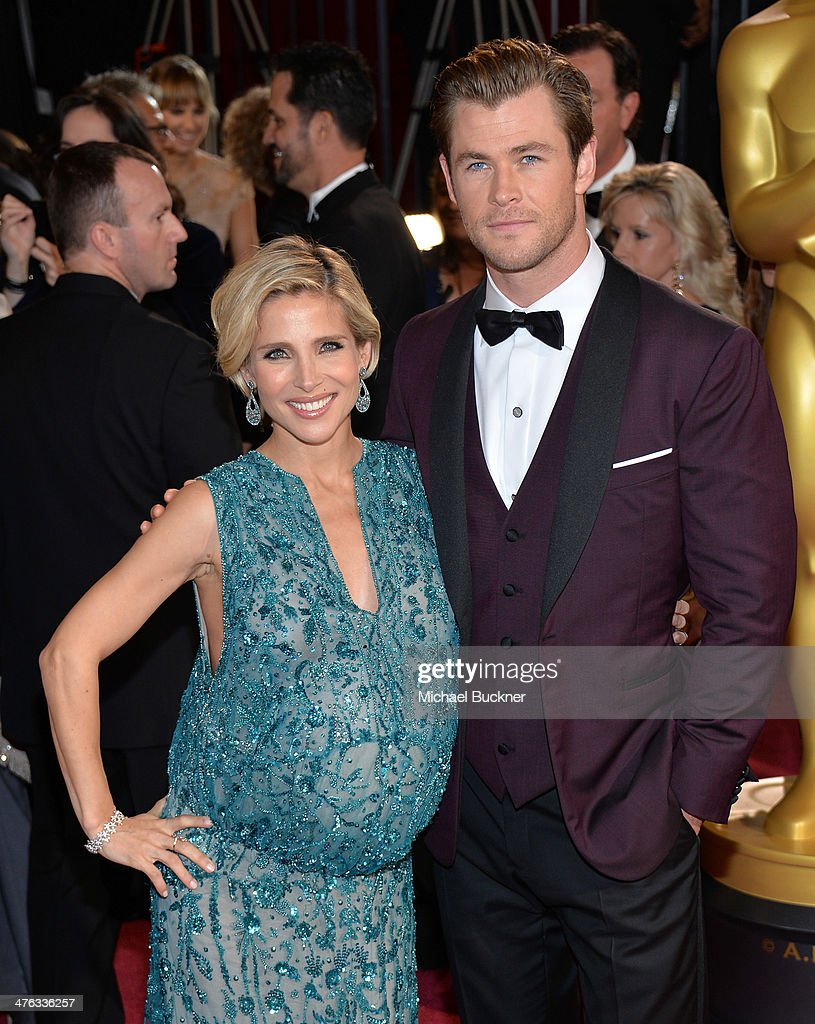Actor Christ Hemsworth (R) and Elsa Pataky attends the Oscars held at Hollywood & Highland Center on March 2, 2014 in Hollywood, California.