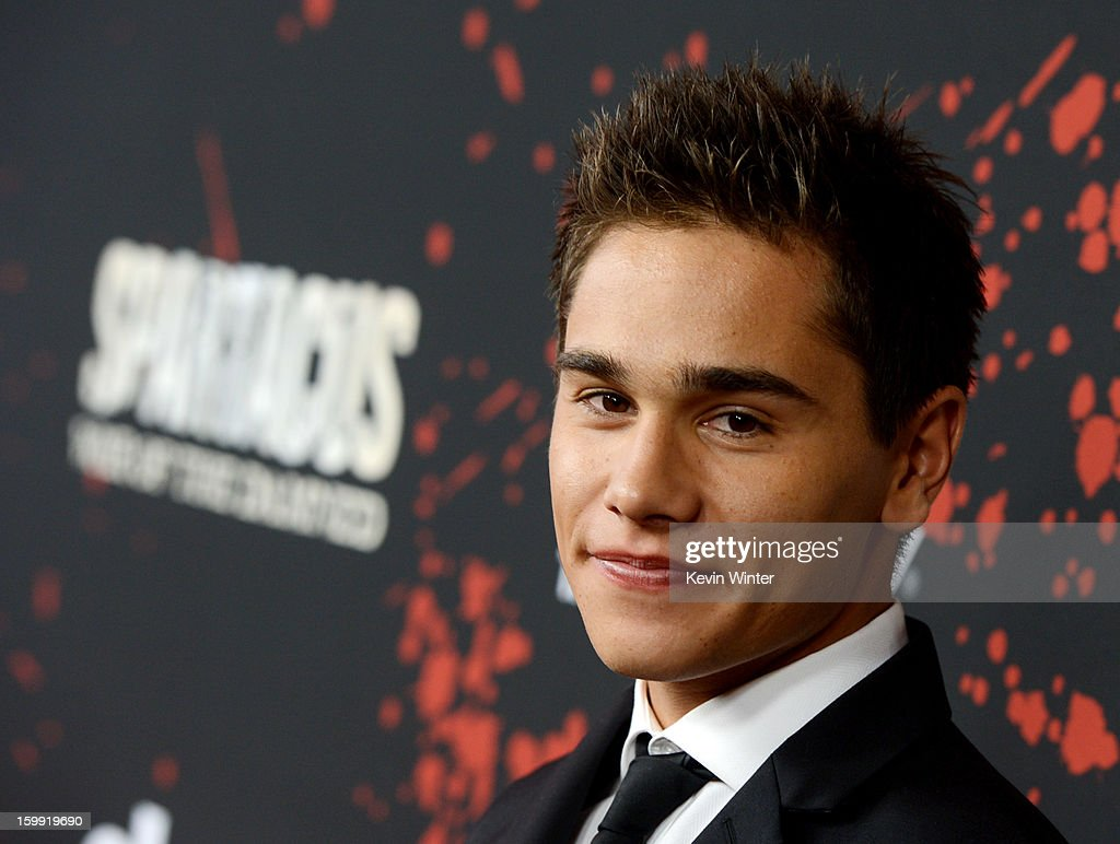 Actor Christian Antidormi arrives at the premiere of Starz's 'Spartacus: War Of The Damned' at the Regal Cinemas L.A. Live on January 22, 2013 in Los Angeles, California.