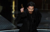 Actor Christian Bale accepts the award for Best Performance by an Actor in a Supporting Role for 'The Fighter' onstage during the 83rd Annual Academy...