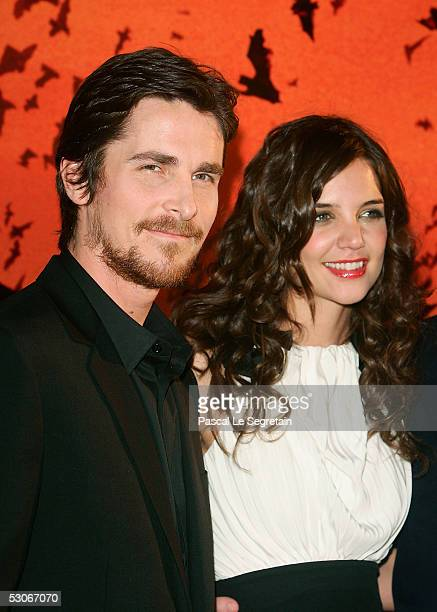 Actor Christian Bale and actress Katie Holmes pose as they attend the Batman Begins premiere on June 14 2005 in Paris France