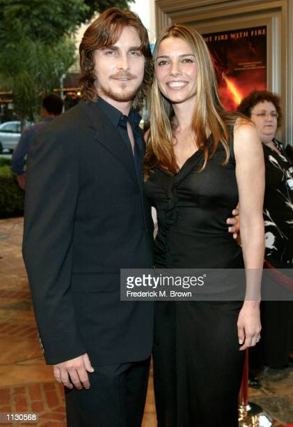 Actor Christian Bale and his wife attend the film premiere of 'Reign Of Fire' July 9 2002 in Los Angeles California 'Reign Of Fire' opens nationwide...