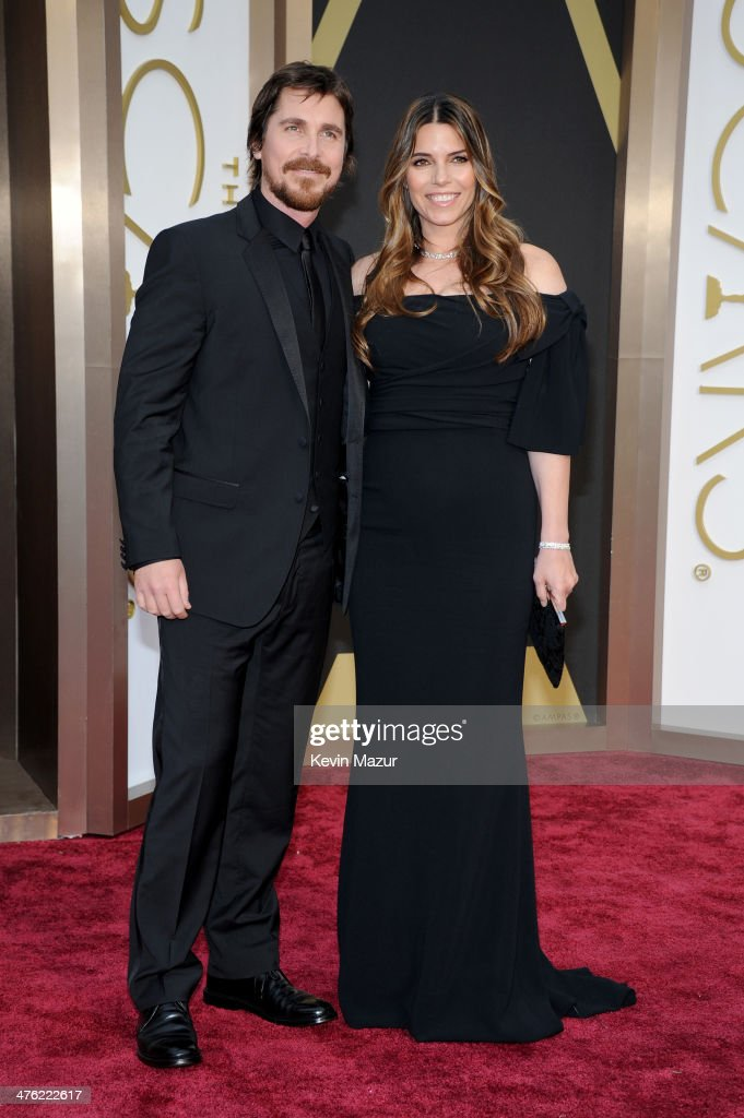 Actor Christian Bale (L) and Sandra Blazic attend the Oscars held at Hollywood & Highland Center on March 2, 2014 in Hollywood, California.