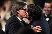 Actor Christian Bale and screenwriter Charles Randolph kiss onstage during the 21st Annual Critics' Choice Awards at Barker Hangar on January 17 2016...