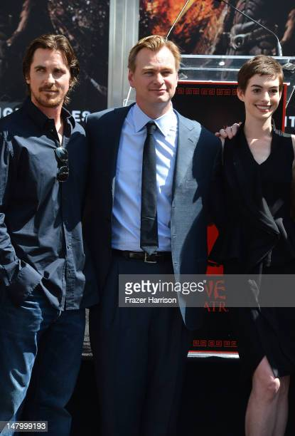 Actor Christian Bale Christopher Nolan and Anne Hathaway attend the Hand and Footprint Ceremony for Director Writer Producer Christopher Nolan at...