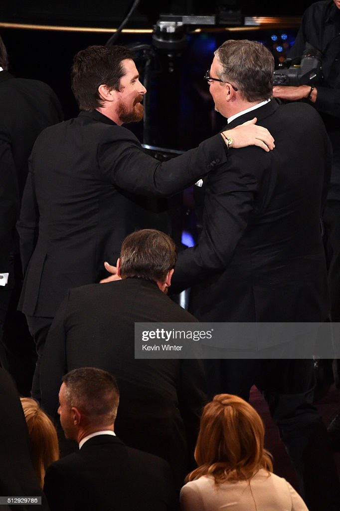 Actor Christian Bale congratulates screenwriterdirector Adam McKay winner of the Best Adapted Screenplay award for 'The Big Short' in the audience...