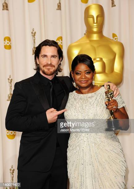 Actor Christian Bale poses with actress Octavia Spencer after she won the Best Supporting Actress Award for 'The Help' in the press room at the 84th...