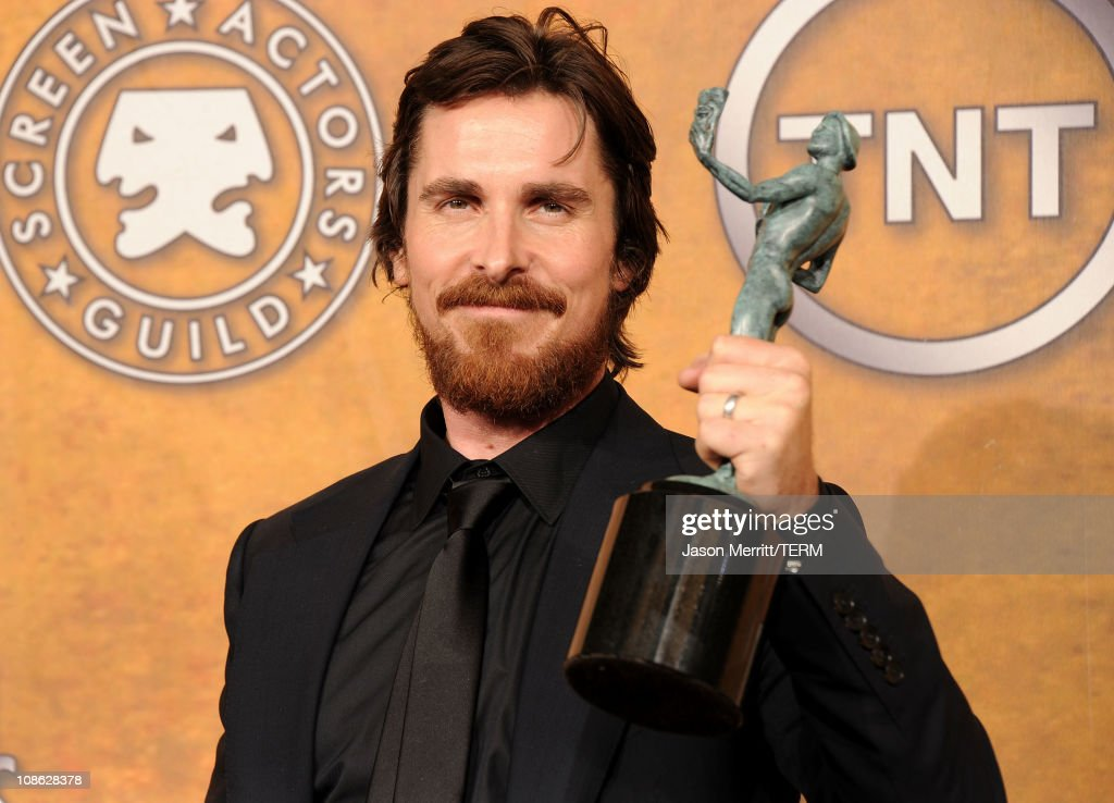 Actor Christian Bale winner of Outstanding Performance by a Male Actor in a Supporting Role award for 'The Fighter' poses in the press room during...
