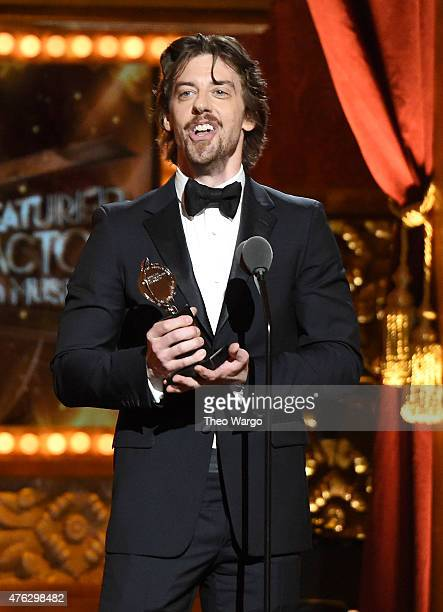 Actor Christian Borle accepts the award for Best Performance by an Actor in a Featured Role in a Musical for Something Rotten onstage at the 2015...