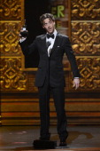 Actor Christian Borle accepts the award for Featured Actor in a Play for 'Peter and the Starcatcher' onstage at the 66th Annual Tony Awards at The...