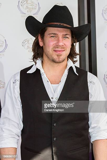 Actor Christian Kane arrives at the 30th Annual Breeder's Cup 'Songs in the Saddle' concert at Santa Anita Park Racetrack on November 2 2013 in...