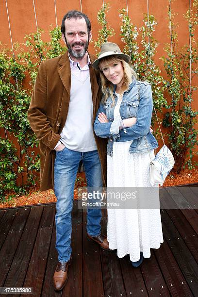 Actor Christian Vadim and his wife Julia Livage attend the 2015 Roland Garros French Tennis Open Day Eight on May 31 2015 in Paris France
