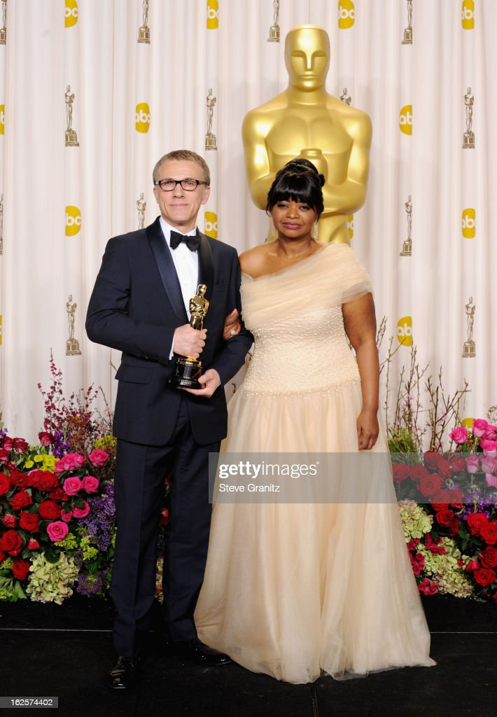Actor Christoph Waltz (L) and presenter Octavia Spencer pose in the press room during the Oscars at the Loews Hollywood Hotel on February 24, 2013 in Hollywood, California.