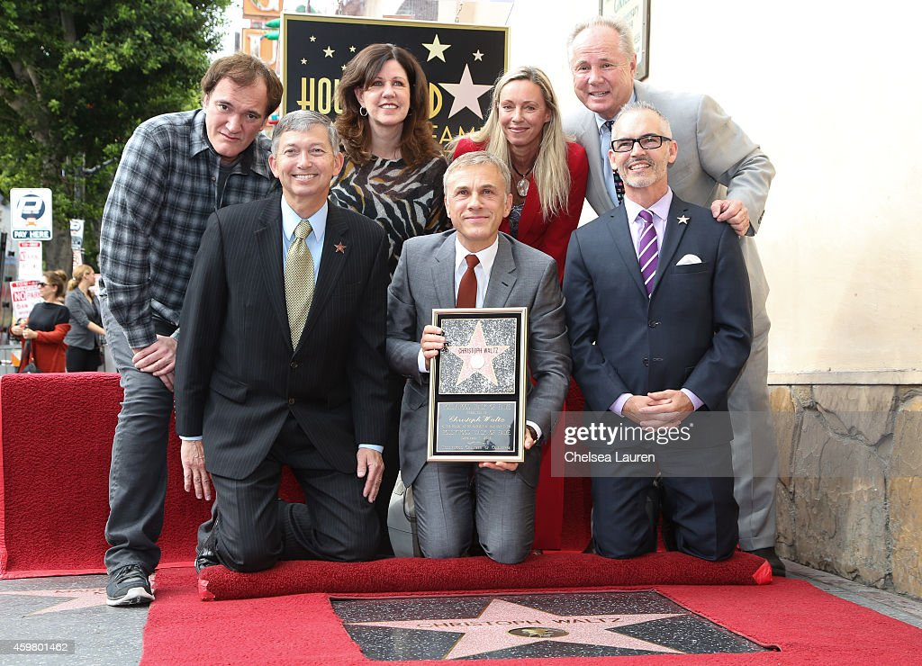 Actor Christoph Waltz (C) attends the ceremony honoring Christoph Waltz with a star on the Hollywood Walk of Fame on December 1, 2014 in Hollywood, California.