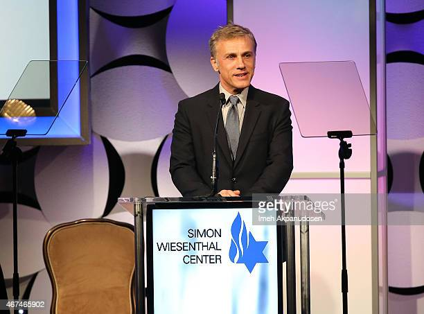 Actor Christoph Waltz speaks onstage at the Simon Wiesenthal Center 2015 National Tribute Dinner honoring Harvey Weinstein at The Beverly Hilton...