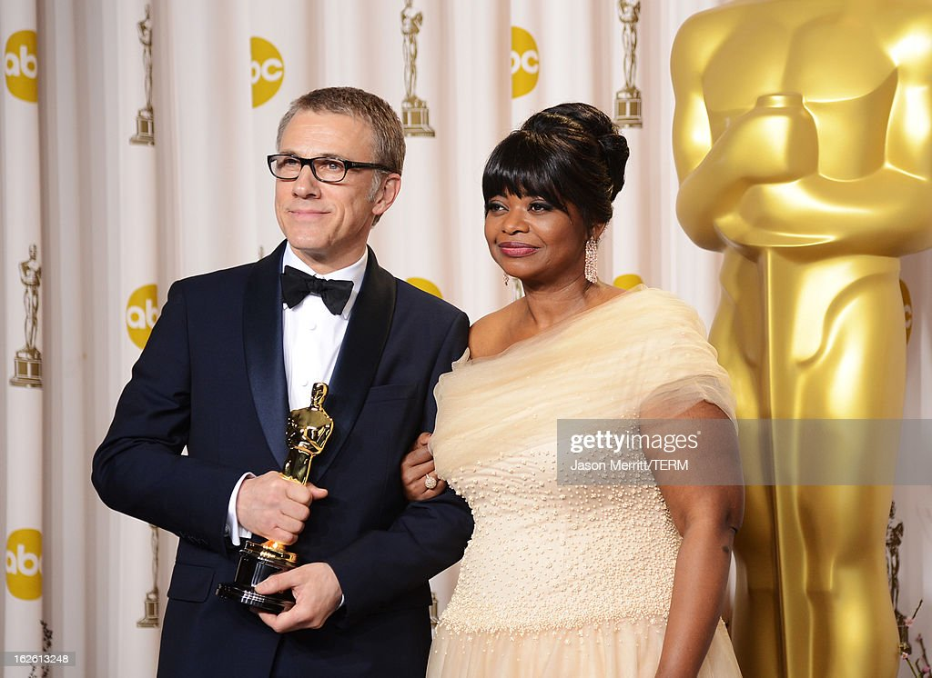 Actor Christoph Waltz, winner of the Best Supporting Actor award for 'Django Unchained,' and presenter Octavia Spencer pose in the press room during the Oscars held at Loews Hollywood Hotel on February 24, 2013 in Hollywood, California.
