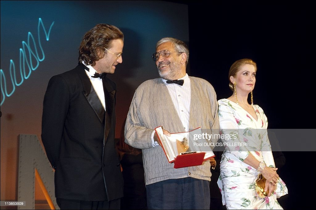 Actor Christophe Lambert, director <a gi-track='captionPersonalityLinkClicked' href=/galleries/search?phrase=Maurice+Pialat&family=editorial&specificpeople=3272910 ng-click='$event.stopPropagation()'>Maurice Pialat</a> and actress <a gi-track='captionPersonalityLinkClicked' href=/galleries/search?phrase=Catherine+Deneuve&family=editorial&specificpeople=123833 ng-click='$event.stopPropagation()'>Catherine Deneuve</a> during the Palmares Of Cannes Film Festival in Cannes, France on May19, 1987 - <a gi-track='captionPersonalityLinkClicked' href=/galleries/search?phrase=Maurice+Pialat&family=editorial&specificpeople=3272910 ng-click='$event.stopPropagation()'>Maurice Pialat</a> won The Golden Palm for the film 'Under the sun of Satan'