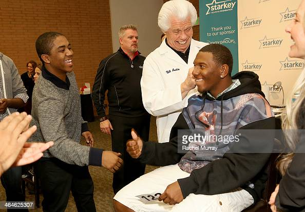 Actor Christopher Massey and Starkey Founder and CEO William Austin assist patients with hearing aids at the Starkey Hearing Foundation Mission...