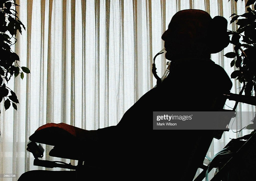 Actor Christopher Reeve is silhouetted as he arrives in his wheelchair at the National Press Club, October 27, 2003 in Washington, DC. Reeve delivered remarks on stem cell research on the 5th anniversary of the discovery of stem cells.