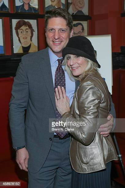 Actor Christopher Sieber and actress Judith Light attend his Sardi's caricature unveiling at Sardi's on November 13 2014 in New York City