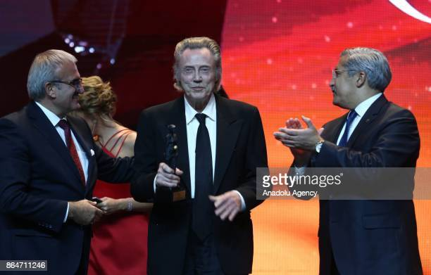 US actor Christopher Walken receives an honor award from Turkish Deputy Culture and Tourism Minister Huseyin Yayman and Antalya Governor Munir...