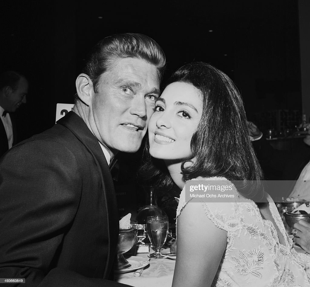 Actor <a gi-track='captionPersonalityLinkClicked' href=/galleries/search?phrase=Chuck+Connors&family=editorial&specificpeople=93230 ng-click='$event.stopPropagation()'>Chuck Connors</a> poses with his wife Kamala Devi in Los Angeles, California.